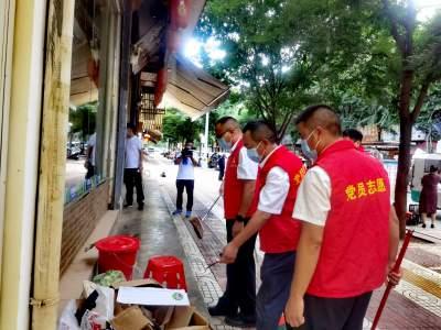 丘北县政府办党支部开展新时代文明实践志愿服务活动